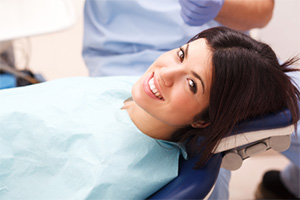 Woman in dental chair smiling