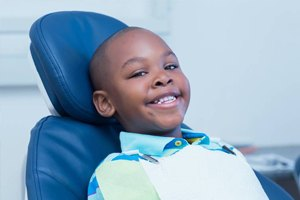 Smiling young boy in dental chair