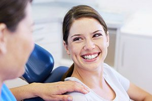 Smiling woman in dentistry chair