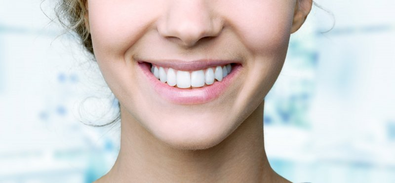 Woman smiling after fluoride treatment